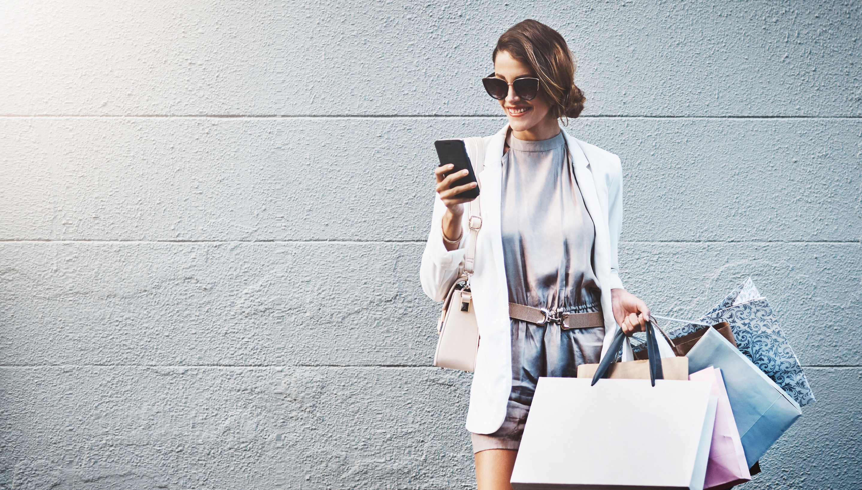 Woman shopping both digitally and traditionally at the store