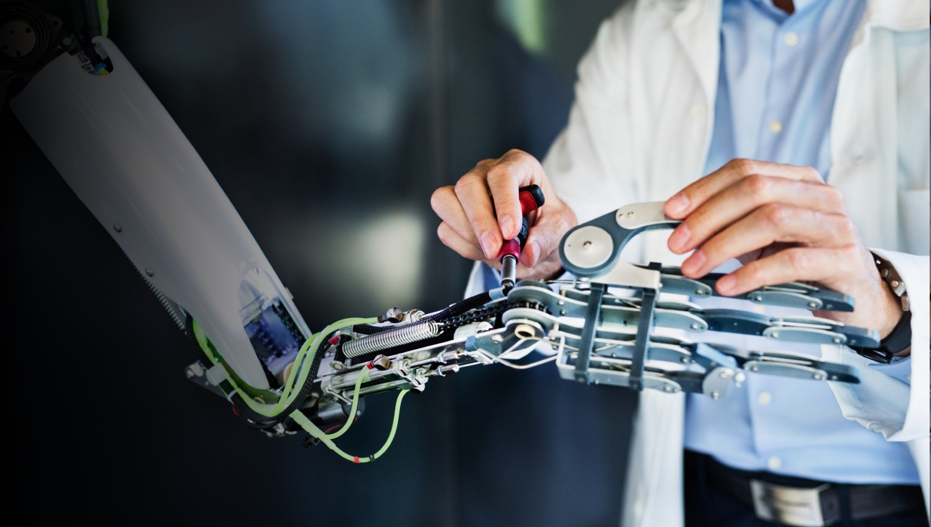 technician working on a robot arm